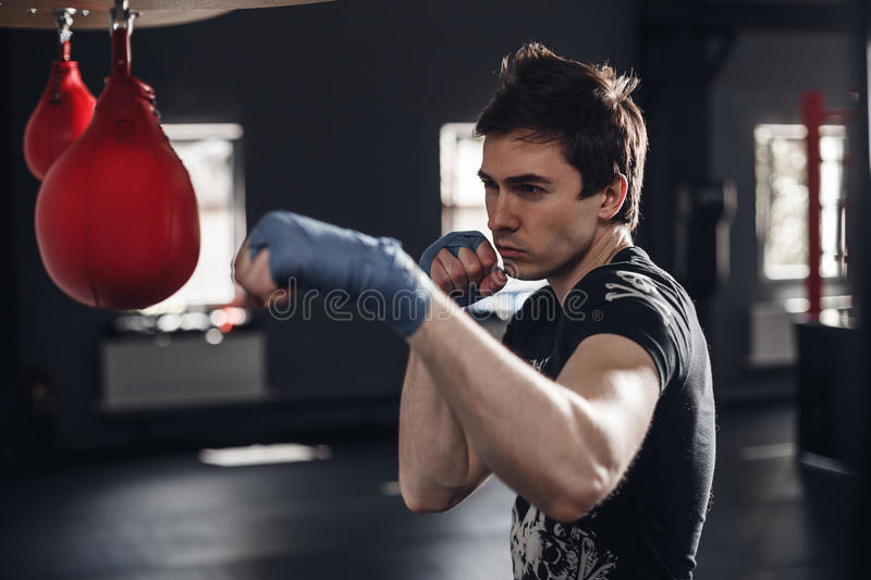 Young man boxing workout in a fitness club royalty free stock photos