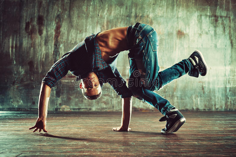 Young man break dancing royalty free stock photography