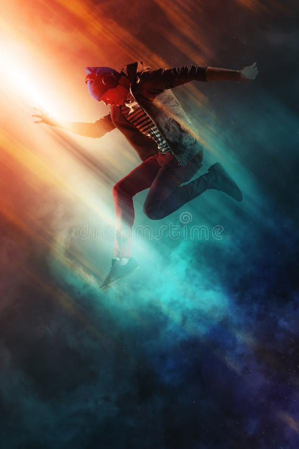 Man break dancing on smoke background royalty free stock images