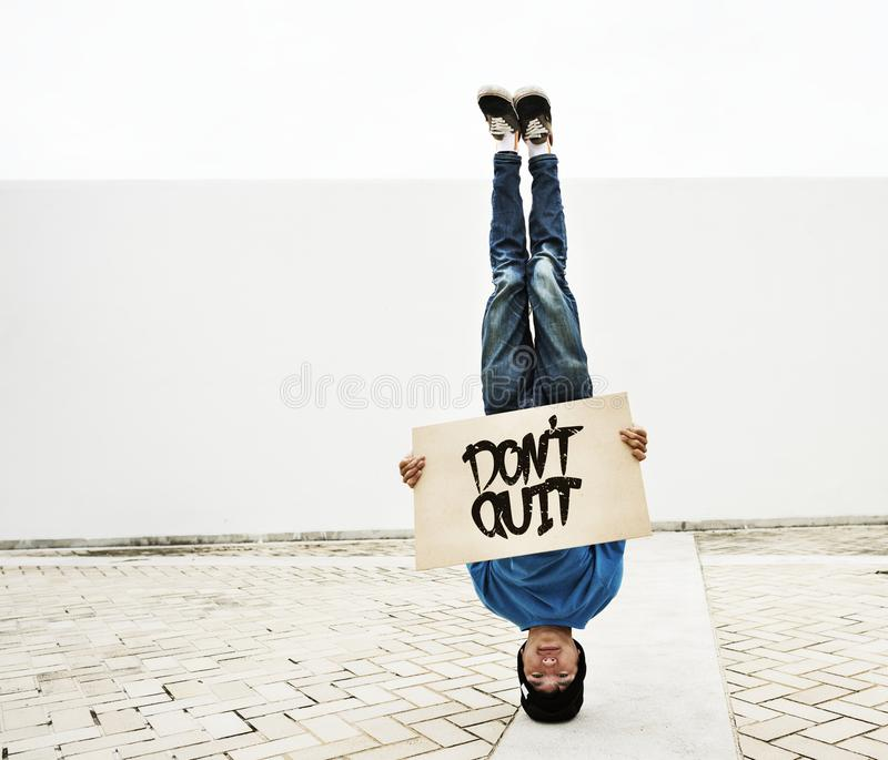 Young man breakdancing. Head stand royalty free stock photos