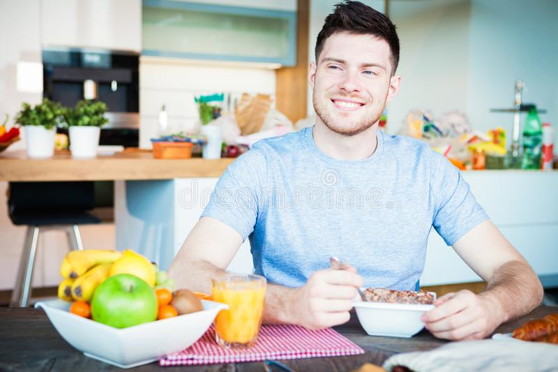 Young man breakfast royalty free stock images