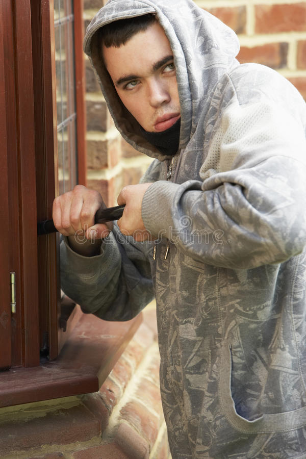 Young Man Breaking Into House stock images
