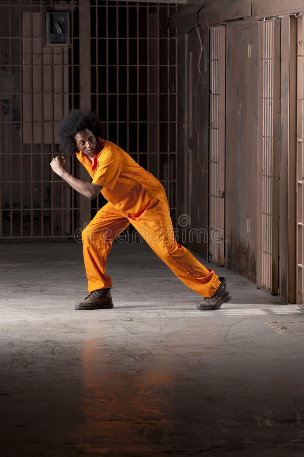Young Man Breaking Out of Prison stock photo