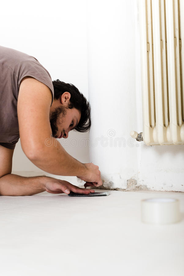 Young man bricolage working. At home stock image