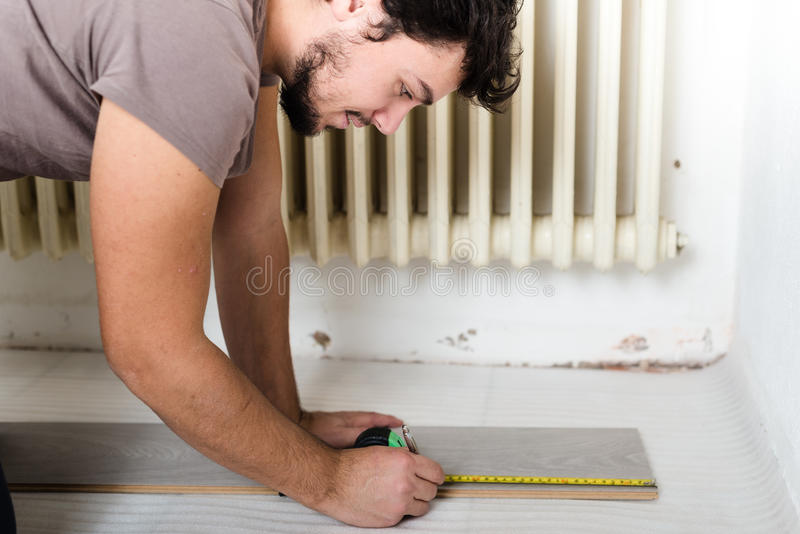 Young man bricolage working. At home stock images