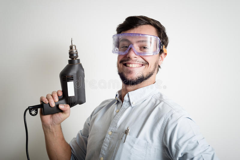 Young man bricolage working. At home royalty free stock photos