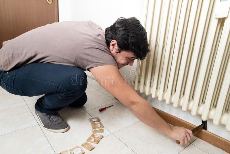 Young man bricolage working. At home royalty free stock image