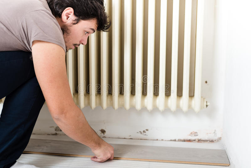 Young man bricolage working. At home royalty free stock photo