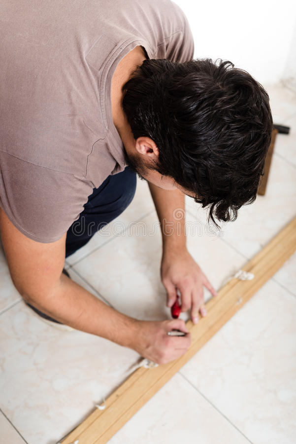 Young man bricolage working. At home royalty free stock images