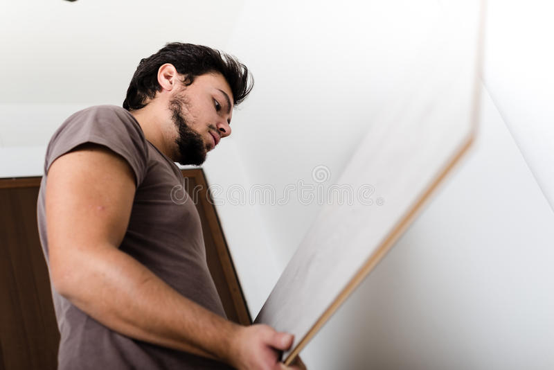 Young man bricolage working. At home stock photography
