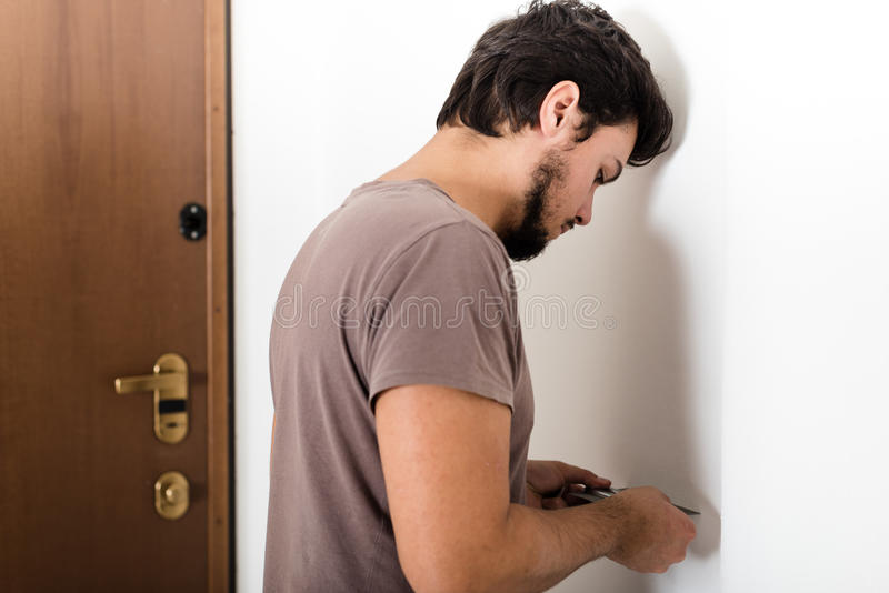 Young man bricolage working. At home stock photos