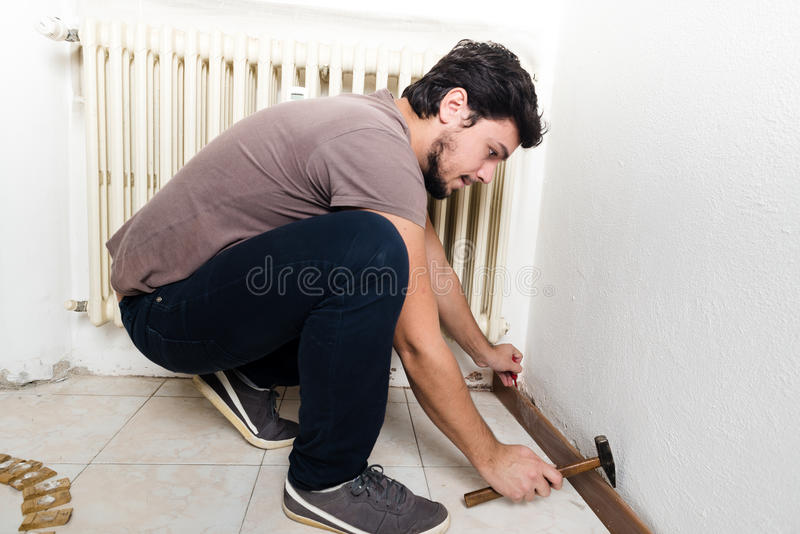 Young man bricolage working. At home royalty free stock photography