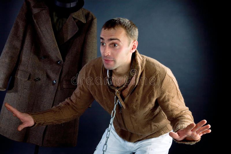 A young man in a brown jacket. That says something stock photos