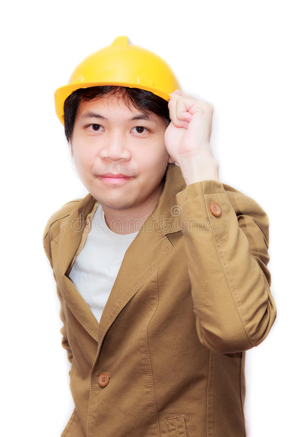 Young man. With brown suit and yellow hard hat stock photo