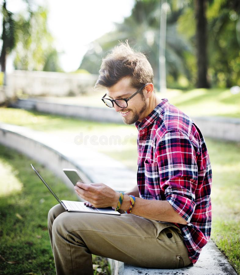 Young Man Browsing Smartphone Concept stock photography