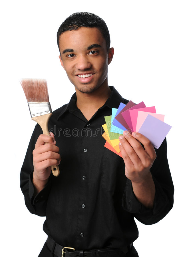 Young Man With Brush and Swatches. Young Man holding a paintbrush and color swatches royalty free stock photo