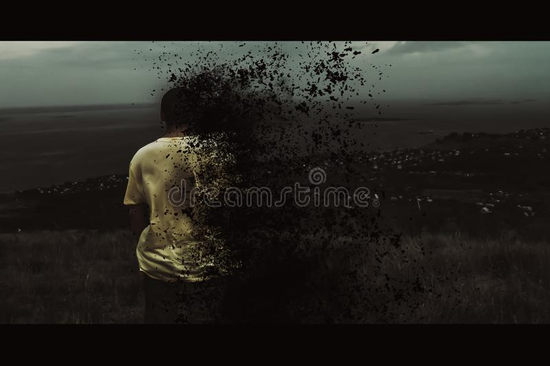 A young man burns on the background of a global catastrophe. A young man is burning against the background of a global catastrophe. Cinema style stock photo