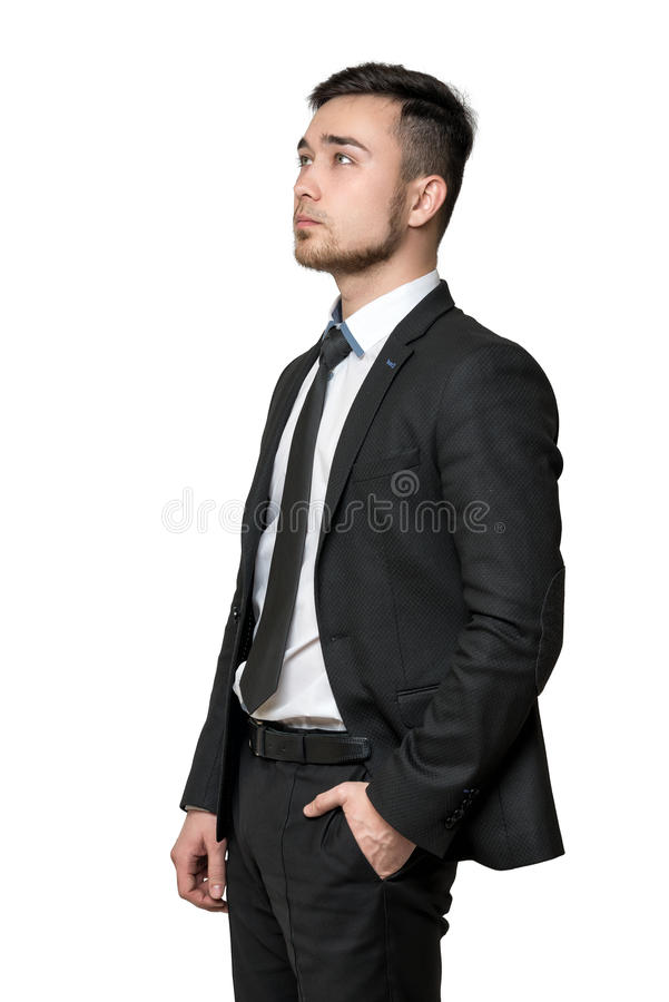 Young man a business suit, hands in his pockets, isolated on white background royalty free stock images