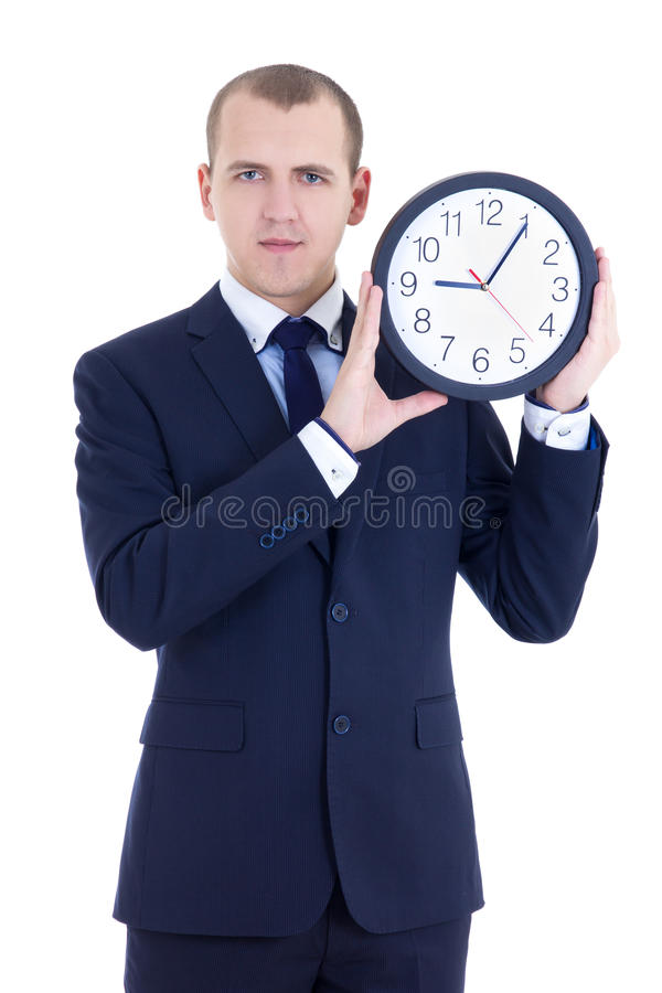 Young man in business suit holding office clock isolated on whit royalty free stock photography