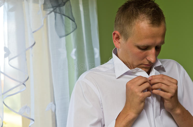 Download Young Man Buttoning White Shirt Stock Image - Image: 32530365