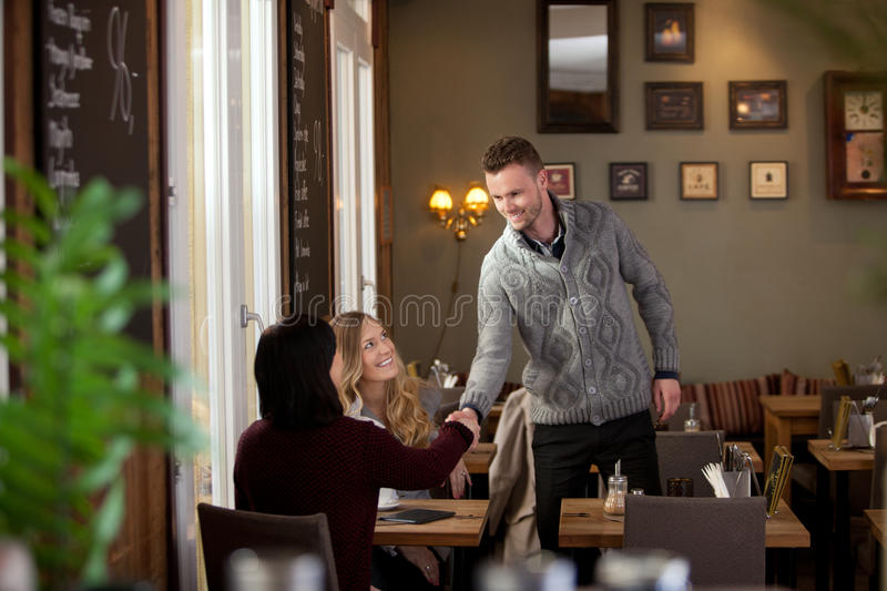 Young Man in Cafe Inroducing Himself stock photography