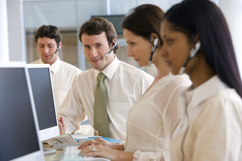 Young man in call center royalty free stock image