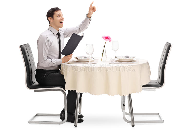 Young man calling the waiter royalty free stock photography