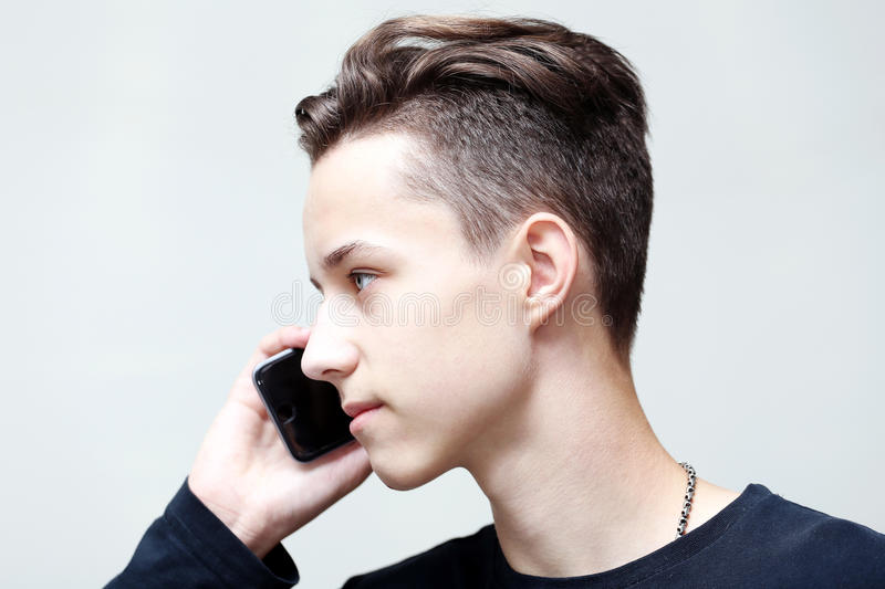 Young man calls by mobile phone stock image