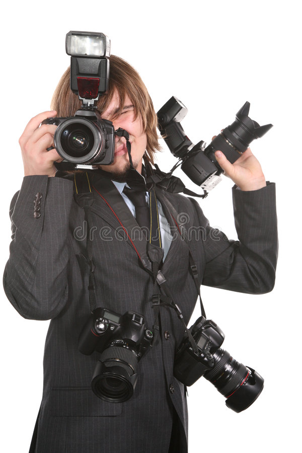 Young man with cameras. Young man with four cameras royalty free stock images