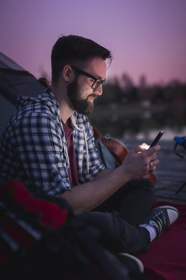 Man camping on the lake stock photo