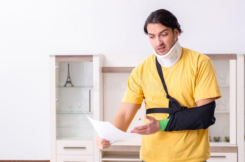Young man after car accident suffering at home stock photos