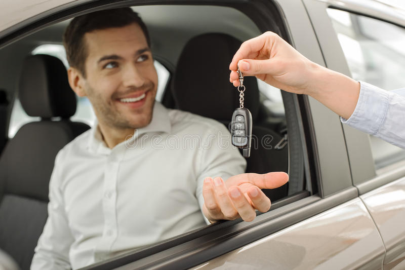 Young Man in a Car Rental Service Test Drive Concept royalty free stock images