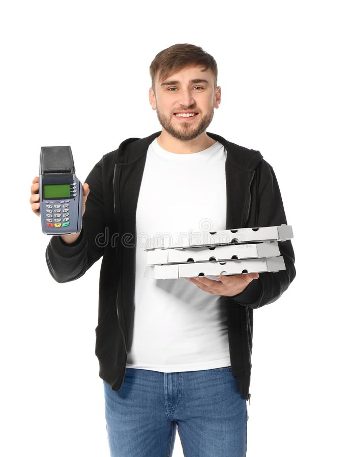 Young man with cardboard pizza boxes and bank terminal on white background. Food delivery service stock image
