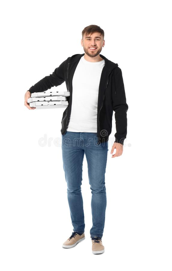 Young man with cardboard pizza boxes on white background. Food delivery service stock image