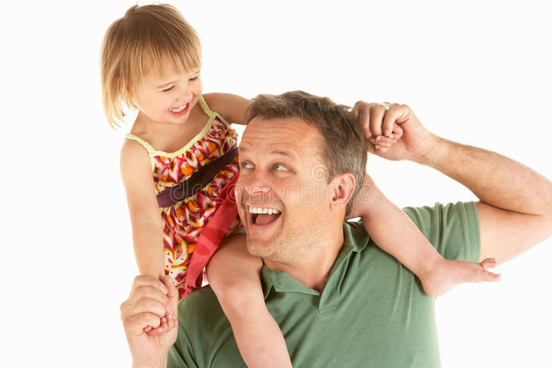 Young man carries child on shoulders royalty free stock photos