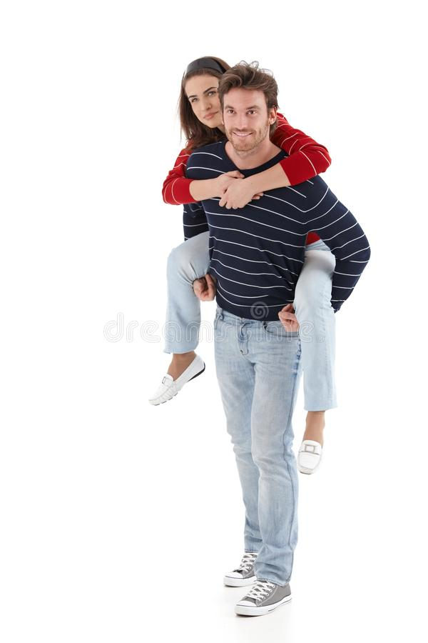 Download Young Man Carrying Woman Pickaback Smiling Stock Photo - Image of cutout, brunette: 21535132