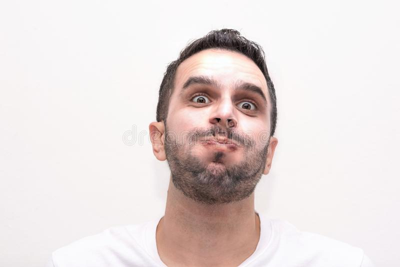 Caucasian male, adult, headshot, Inflates his cheeks stock photography