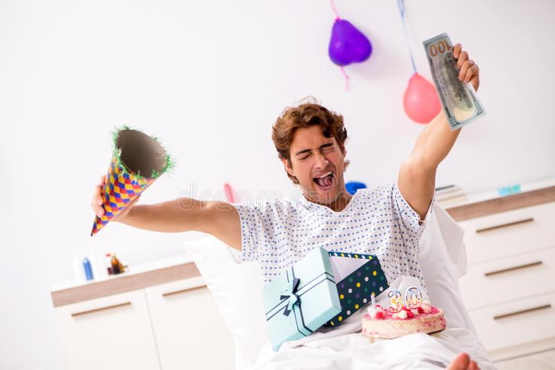 The young man celebrating his birthday in hospital. Young man celebrating his birthday in hospital royalty free stock images