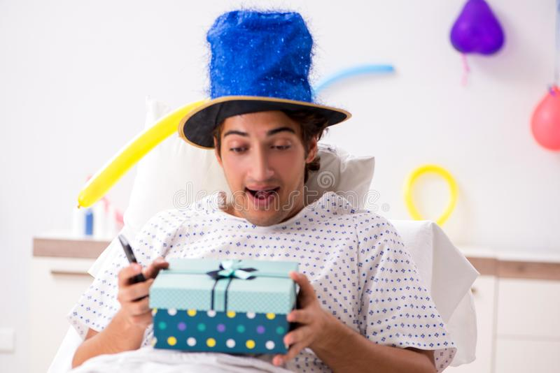 The young man celebrating his birthday in hospital. Young man celebrating his birthday in hospital royalty free stock photos
