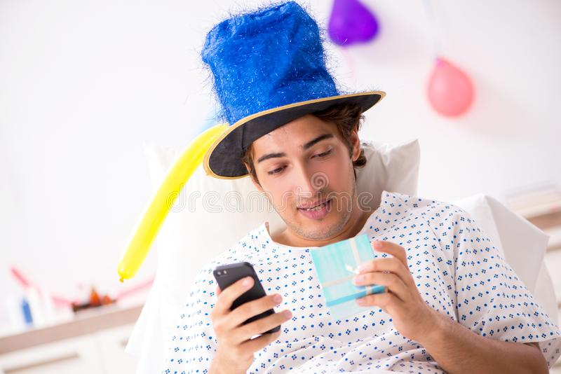 The young man celebrating his birthday in hospital. Young man celebrating his birthday in hospital stock photos