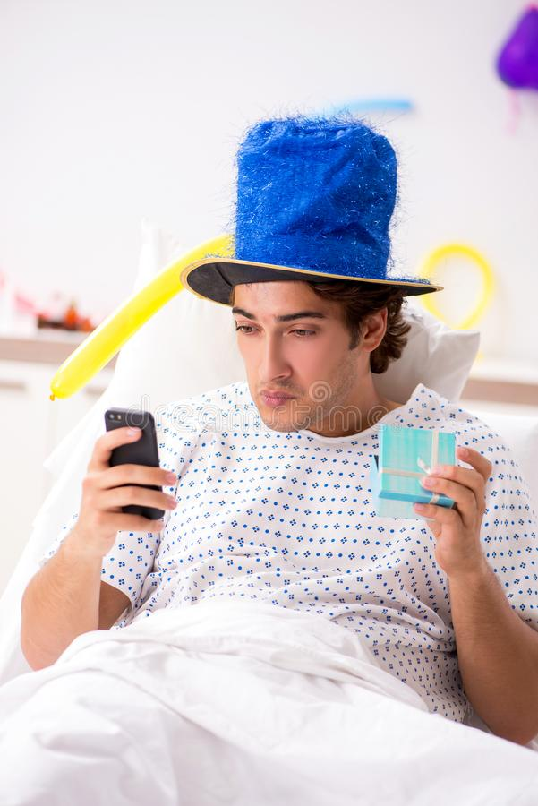The young man celebrating his birthday in hospital. Young man celebrating his birthday in hospital royalty free stock image