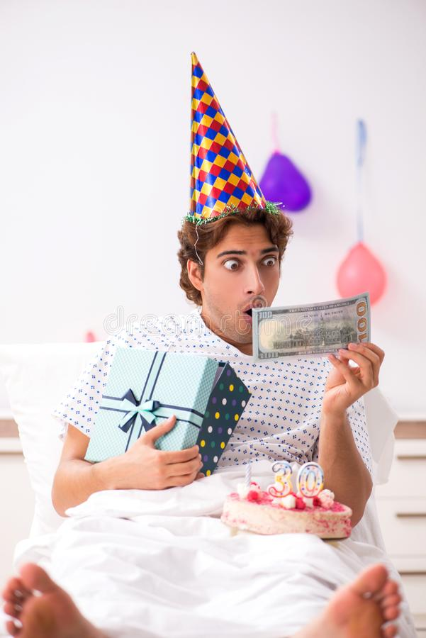 The young man celebrating his birthday in hospital. Young man celebrating his birthday in hospital royalty free stock photo