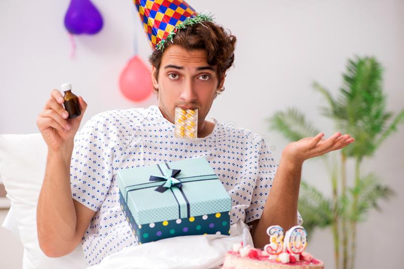 The young man celebrating his birthday in hospital. Young man celebrating his birthday in hospital stock images