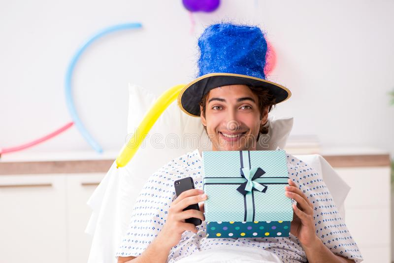The young man celebrating his birthday in hospital. Young man celebrating his birthday in hospital stock image