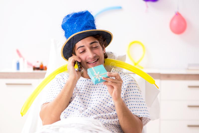 The young man celebrating his birthday in hospital. Young man celebrating his birthday in hospital stock photo