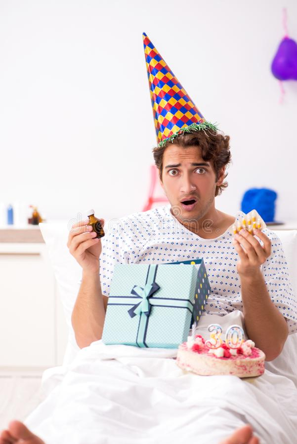 The young man celebrating his birthday in hospital. Young man celebrating his birthday in hospital stock photography