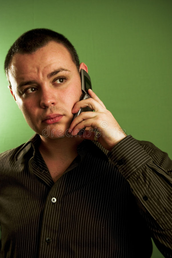 Young man on cell phone stock photos