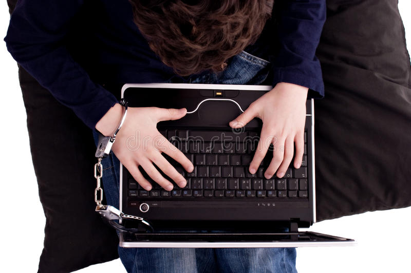 Young man chained to the computer royalty free stock photos