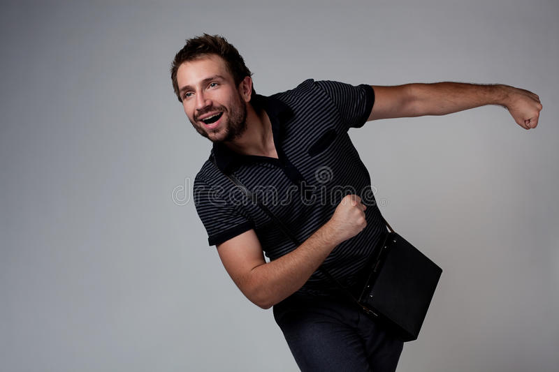 Young Man Chasing Stock Photo