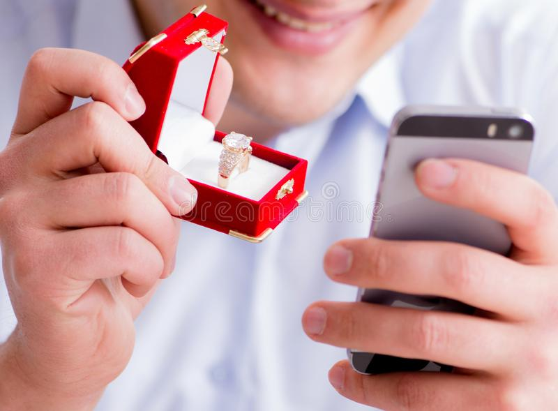 Young man chatting with his sweetheart over mobile phone stock images